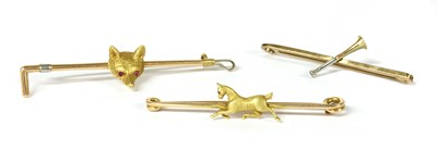 Lot 36-A group of gold equestrian brooches