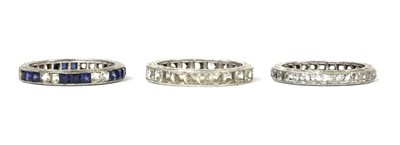 Lot 58 - Three silver paste set full eternity rings