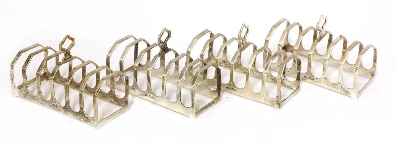 Lot 18-A set of four silver toast racks
