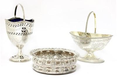 Lot 28 - Two Victorian silver sugar baskets