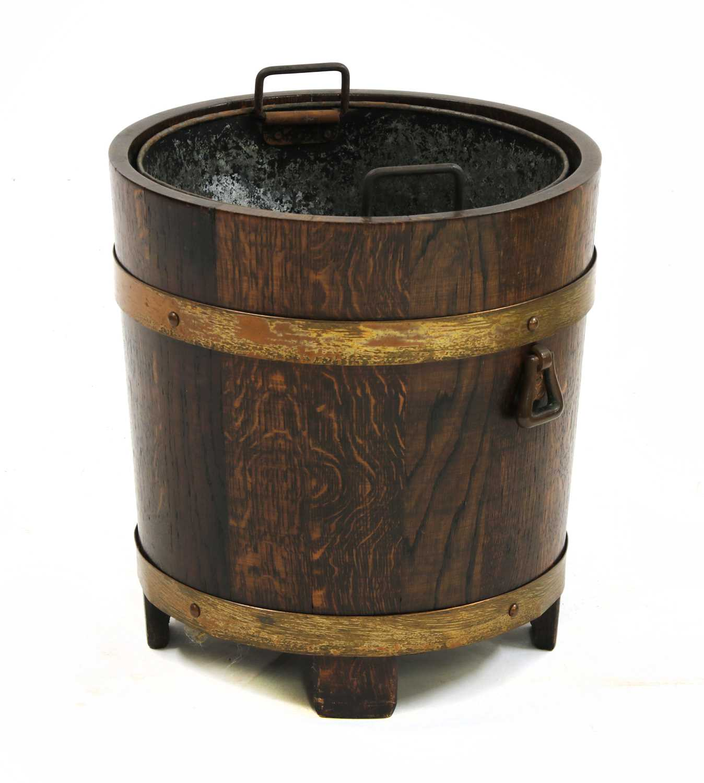 Lot 31-An oak and copper coal bucket