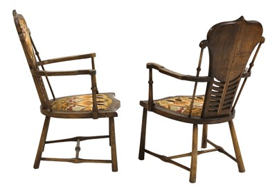 Lot 30-A pair of Art Nouveau mahogany and beech armchairs
