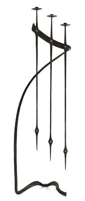 Lot 135 - A wrought iron three-branch standing candelabra