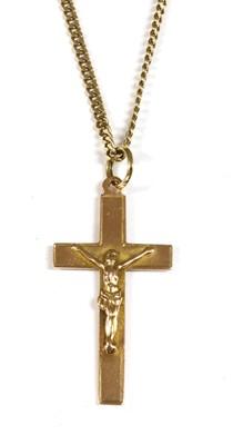 Lot 42-A 9ct rose gold crucifix