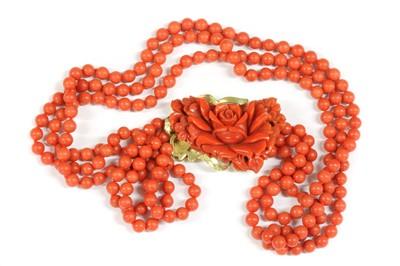Lot 46-An Italian gold three row uniform coral bead necklace