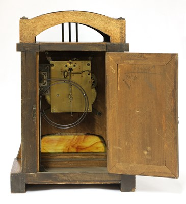 Lot 54 - A Secessionist oak and brass-mounted mantel clock