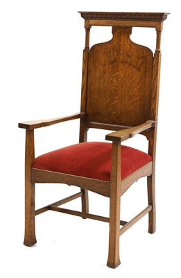 Lot 156 - An Arts and Crafts oak-framed throne armchair