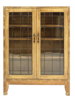 Lot 134 - An Arts and Crafts oak glazed bookcase