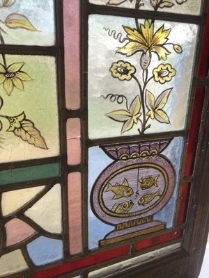 Lot 35-An Arts and Crafts stained glass panel
