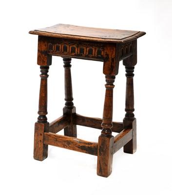 Lot 98 - An oak joint stool