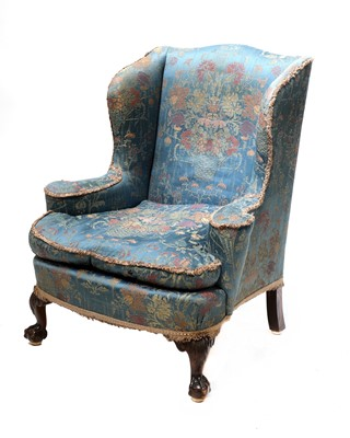 Lot 47 - A silk upholstered wingback armchair