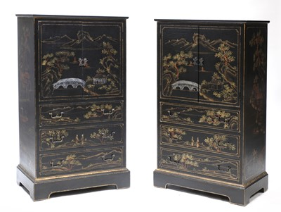 Lot 48 - A pair of chinoiserie ebonised, painted and gilt cabinets