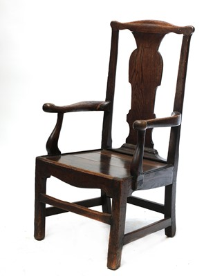 Lot 100 - A substantial oak country open armchair