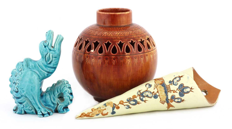 Lot 61 - A Burmantofts faience turquoise dragon spoon warm