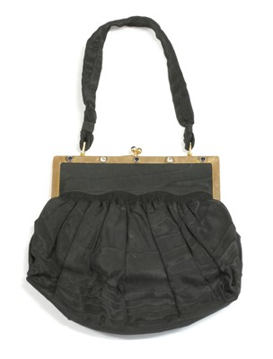 Lot 73 - An Edwardian 9ct gold sapphire and diamond set watermark black taffeta evening bag, by Asprey & Co.