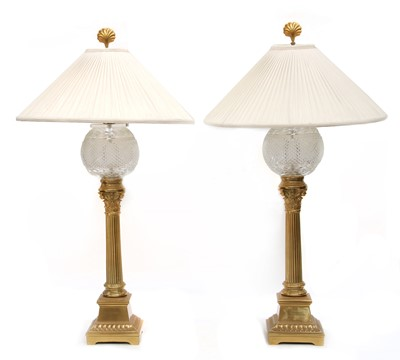 Lot 72 - A pair of gilt brass and glass table lamps