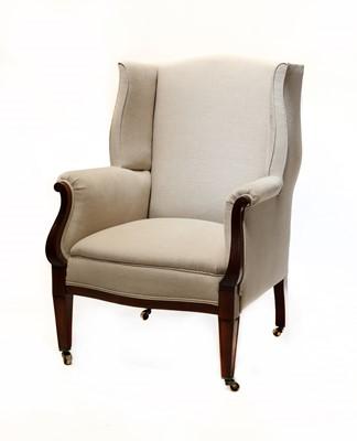 Lot 73 - A mahogany wingback armchair