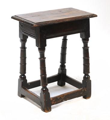 Lot 74 - An oak joint stool