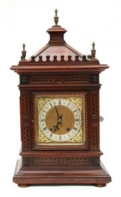 Lot 53 - A Victorian walnut mantel clock