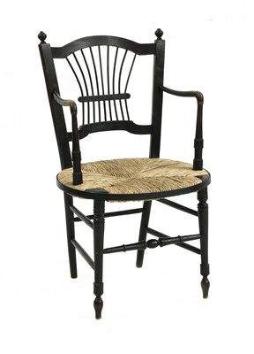 Lot 72 - A Morris & Co. ebonised elbow chair