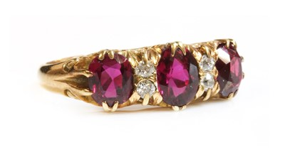 Lot 44 - A seven stone ruby and diamond carved head ring