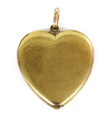 Lot 85 - A gold heart-shaped swivel locket, c.1910