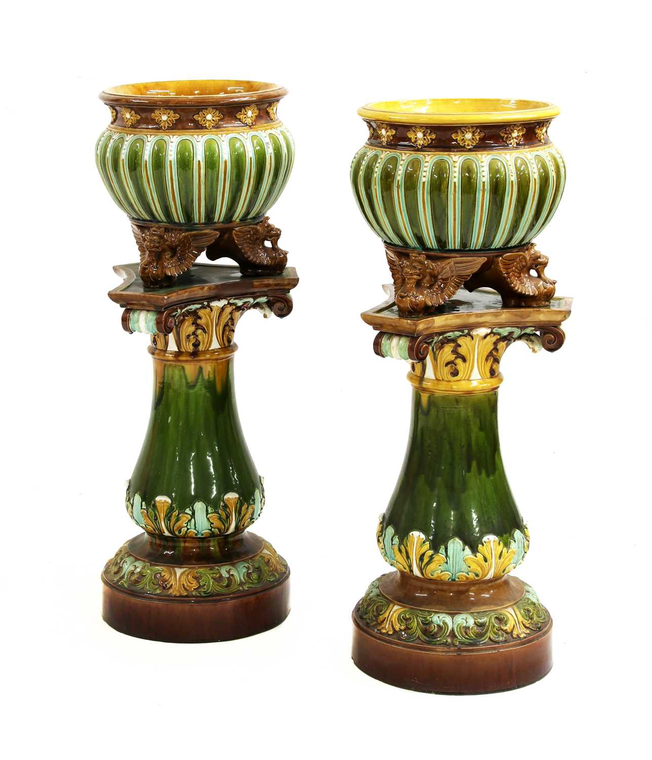 Lot 6 - A pair of Doulton Lambeth stoneware jardinières on stands