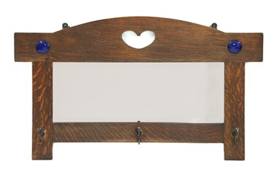 Lot 168 - An Arts and Crafts oak hall mirror