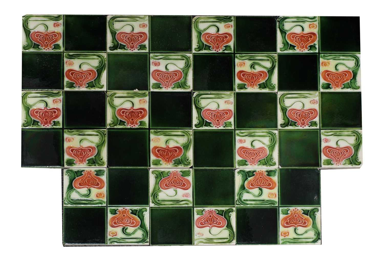 Lot 147 - A set of ten glazed Art Nouveau design tiles