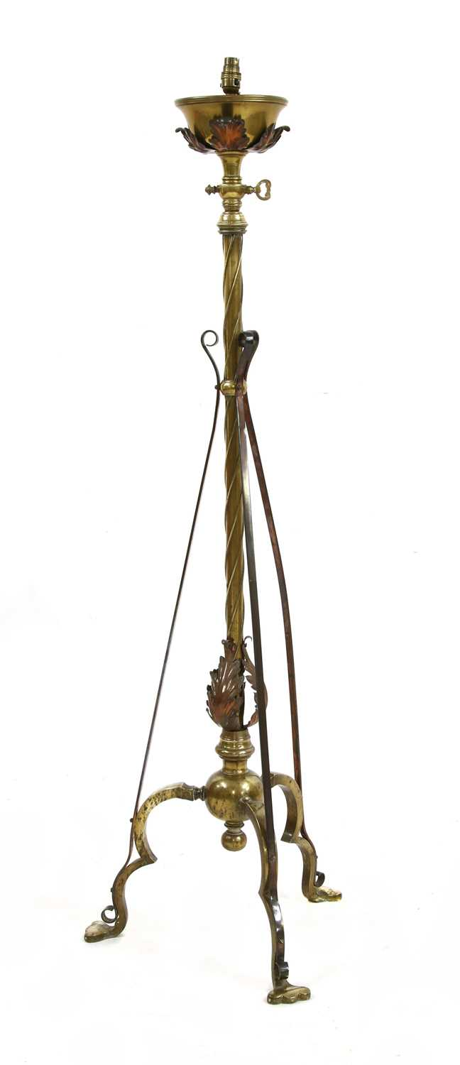 Lot 20-An Arts and Crafts brass and copper-mounted standard lamp