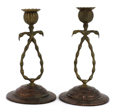 Lot 67 - A pair of brass and copper candlesticks