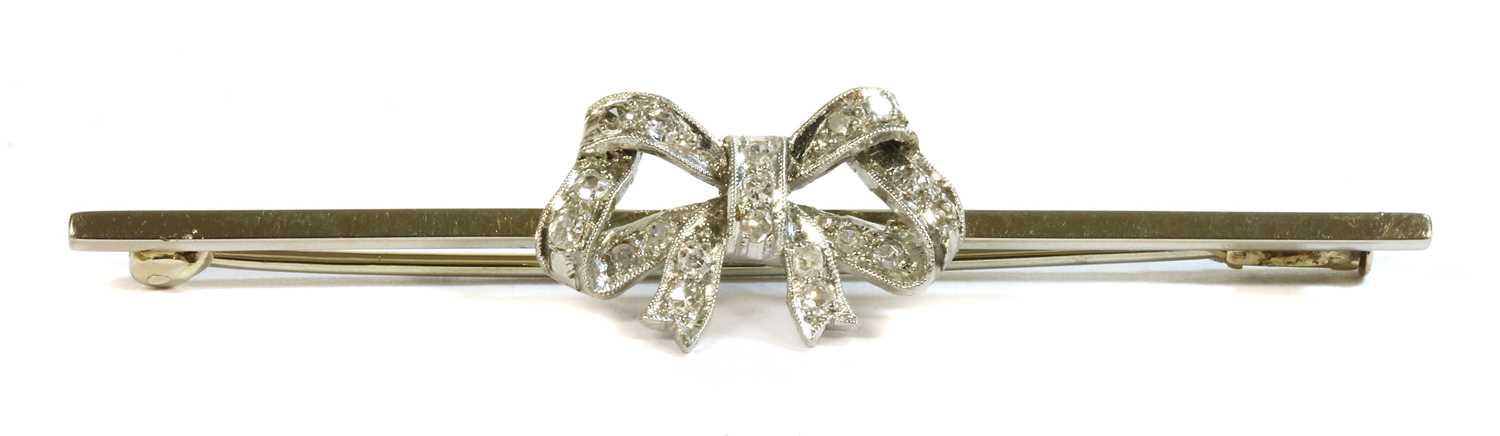 Lot 3 - A white gold diamond set bow brooch, c.1925