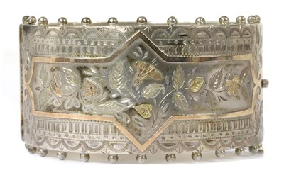 Lot 23 - A late Victorian sterling silver hinged bangle