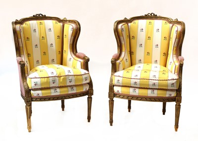 Lot 67 - A pair of French Louis XVI-style giltwood fauteuils
