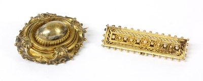 Lot 19-A Victorian Etruscan Revival gold shield form brooch