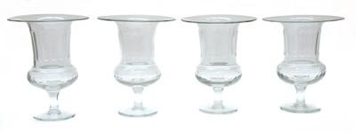 Lot 51 - A set of four glass celery vases