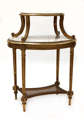 Lot 66 - A French oval two-tier étagère