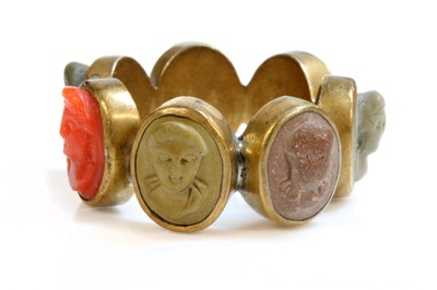 Lot 8 - A late Georgian gilt metal specimen lava and coral cameo ring