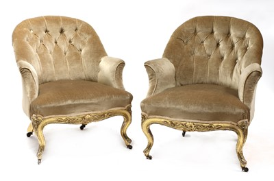 Lot 83 - A pair of Victorian giltwood salon tub chairs