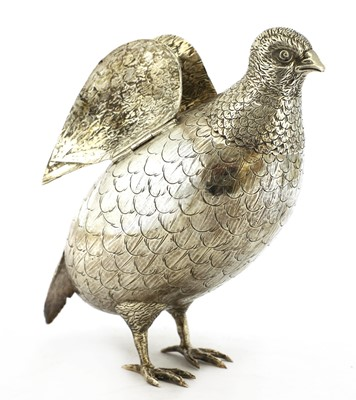 Lot 11-A large silver model of a partridge