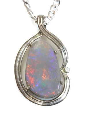 Lot 111 - A white gold, opal and diamond pendant