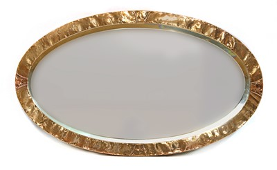 Lot 174 - An Arts and Crafts oval copper mirror