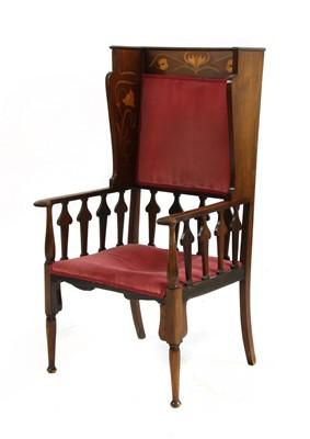 Lot 153 - A mahogany inlaid wingback armchair