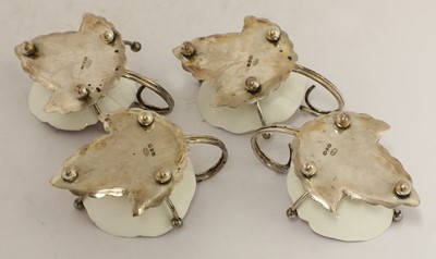 Lot 46 - A set of four silver and pottery cups