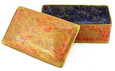 Lot 375 - A Wedgwood 'Celestial Dragon' orange lustre cigarette box and cover