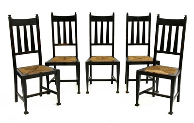 Lot 165 - A set of five Arts and Crafts oak and ebonised chairs