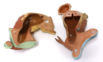 Lot 365 - Two Austrian glazed pottery wall masks
