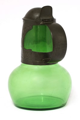 Lot 124 - A Tudric pewter and green glass claret jug and cover