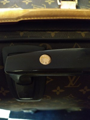 Lot 110 - A Louis Vuitton monogrammed canvas 'Pégase Légère 55' suitcase
