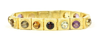Lot 8-A Victorian gold assorted gemstone panel bracelet